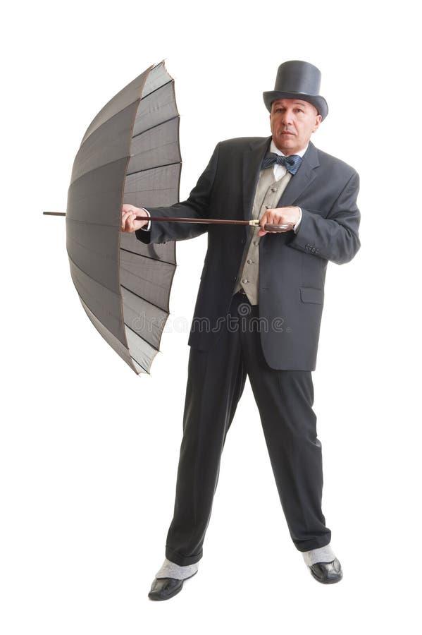 在一套减速火箭的西装的商人 免版税图库摄影