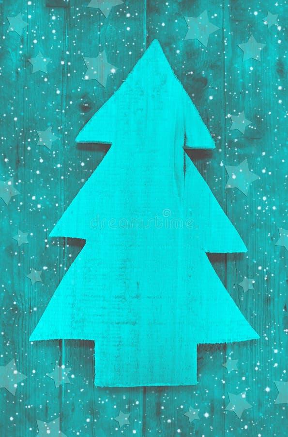 在一手工制造carv的绿松石绿色的圣诞节背景 免版税图库摄影