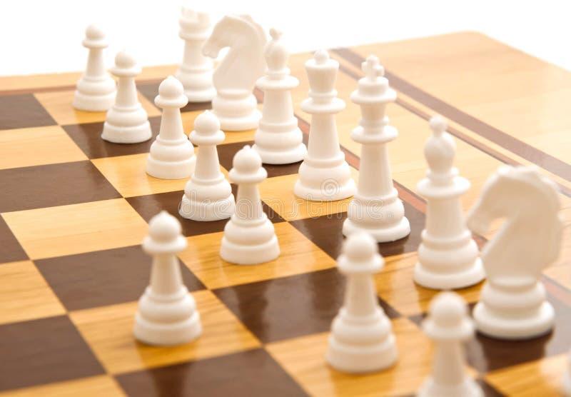 在一杆棋枰的棋在白色 免版税库存图片