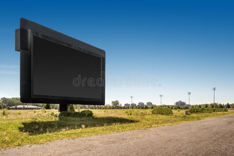 在一条被放弃的马轨道的巨型屏幕 免版税库存照片