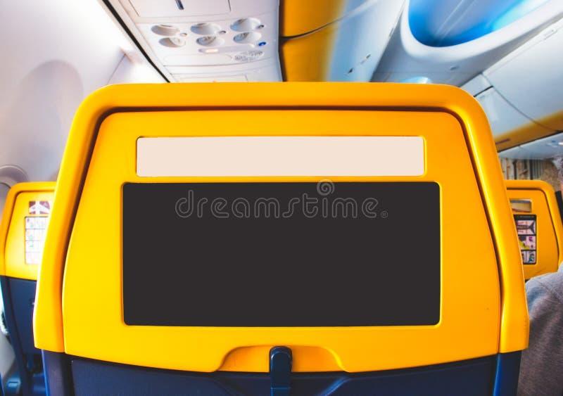 在一架民航飞机上的一个乘客座位有拷贝空间的空的区域的 图库摄影