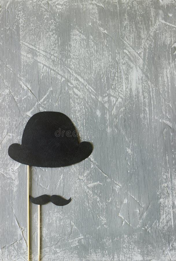在一根棍子的纸辅助部件在度假或党的一张照片写真的 具体背景 图库摄影