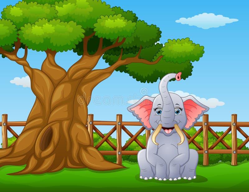 在一棵树旁边的动物大象在篱芭里面 皇族释放例证