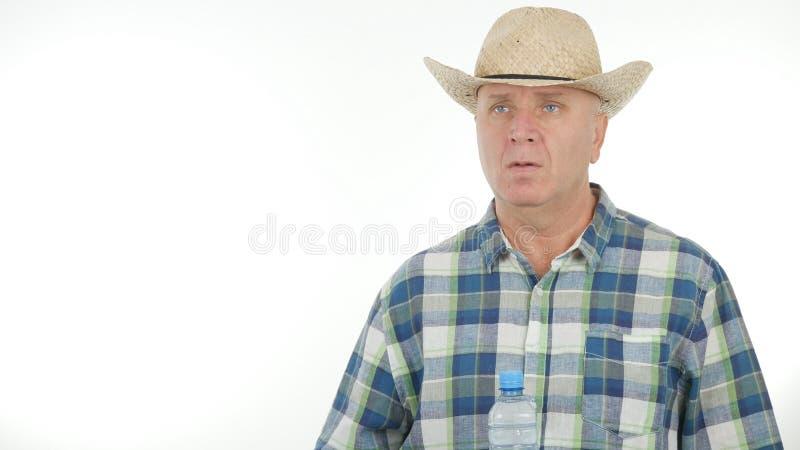 在一次农业采访的确信的农夫图象 免版税库存照片
