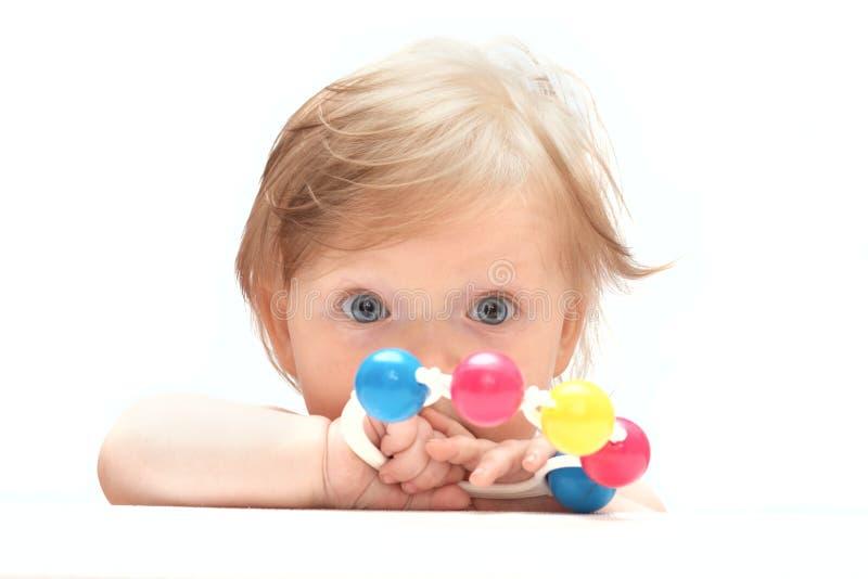在一点片剂白色之后的婴孩 免版税库存照片