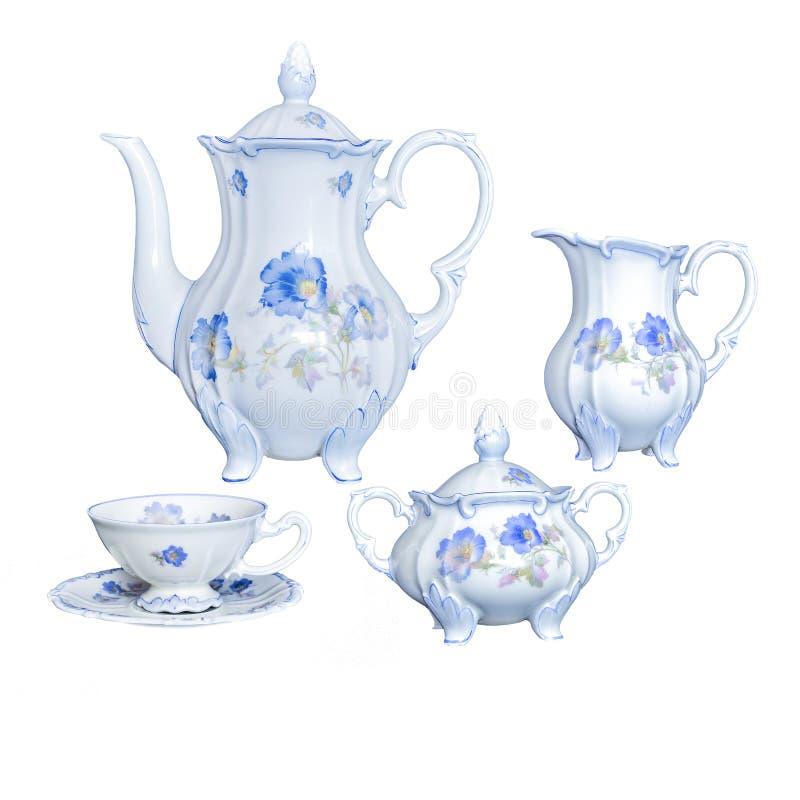 在一白色backgro的葡萄酒古色古香的典雅的瓷茶器物 免版税库存图片