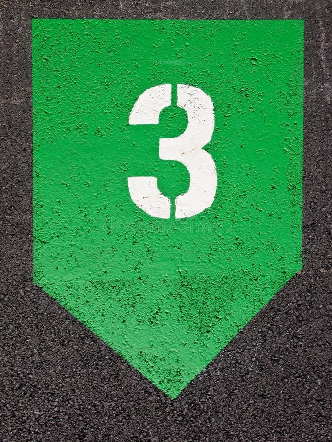 在一绿色几何symb的白色油漆三模板印刷的第 免版税库存照片