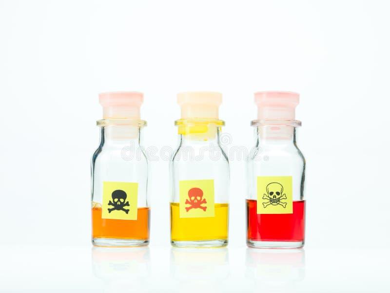 在三个不同瓶的色的毒液体 库存照片