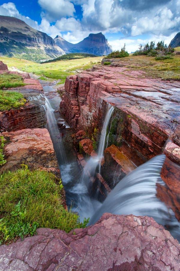 在三倍的日落在冰川国家公园,蒙大拿,美国下跌 库存图片