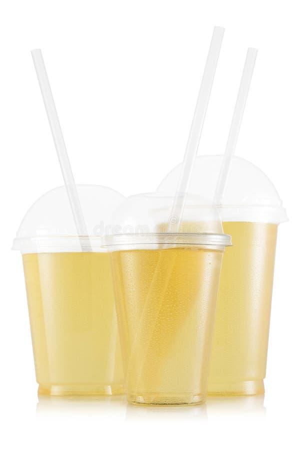 在三杯子的大小的汁液 库存图片