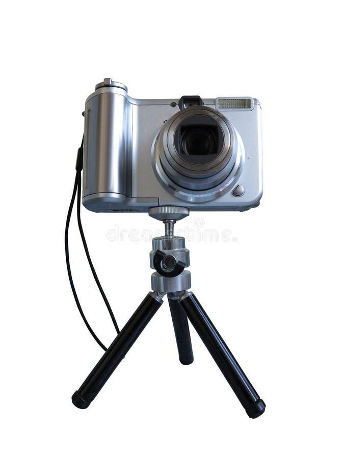 在三脚架的灰色数字式照片照相机被隔绝在白色 免版税库存照片