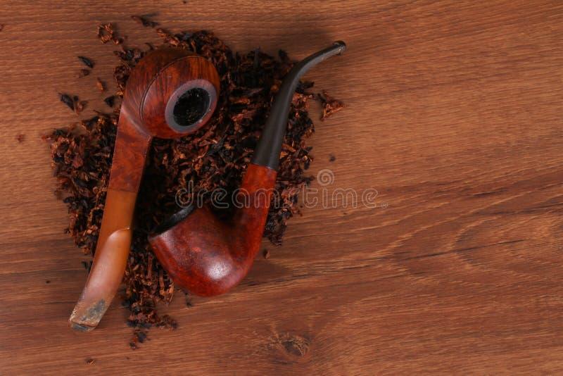在不健康的木头的Tabacco管子 免版税库存照片