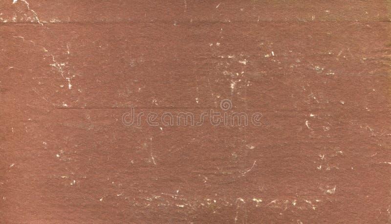 在不良状态的肮脏和被抓的老棕色书套 免版税库存图片