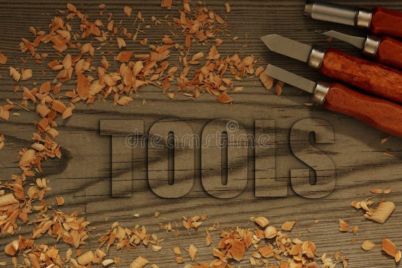 在与凿子的木头雕刻的工具 库存图片