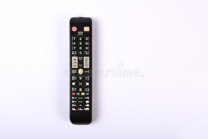 在与拷贝的白色隔绝的电视遥控,老和多灰尘遥控 免版税库存照片