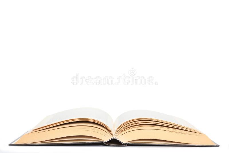 在与拷贝空间的白色背景隔绝的开放书您的文本的 库存图片