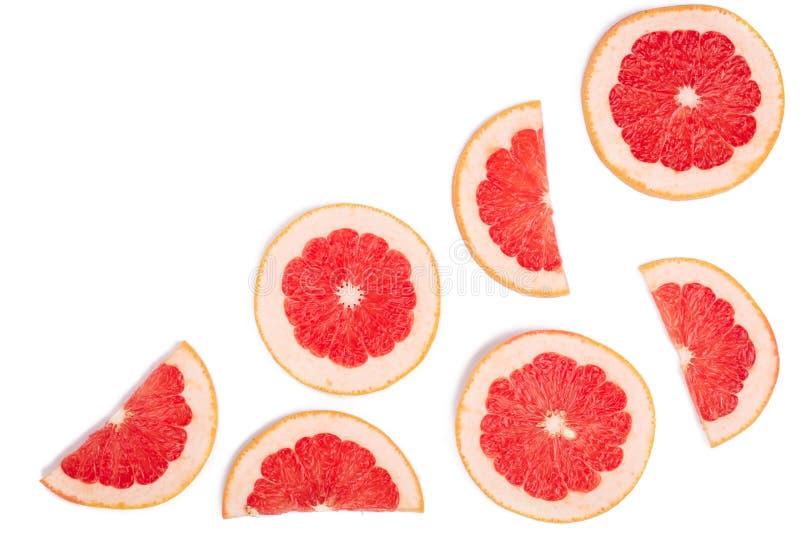 在与拷贝空间的白色背景隔绝的葡萄柚切片您的文本的 顶视图 平的位置样式 免版税库存照片