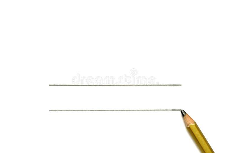 在与线的纯净的白色背景隔绝的金铅笔 免版税库存照片