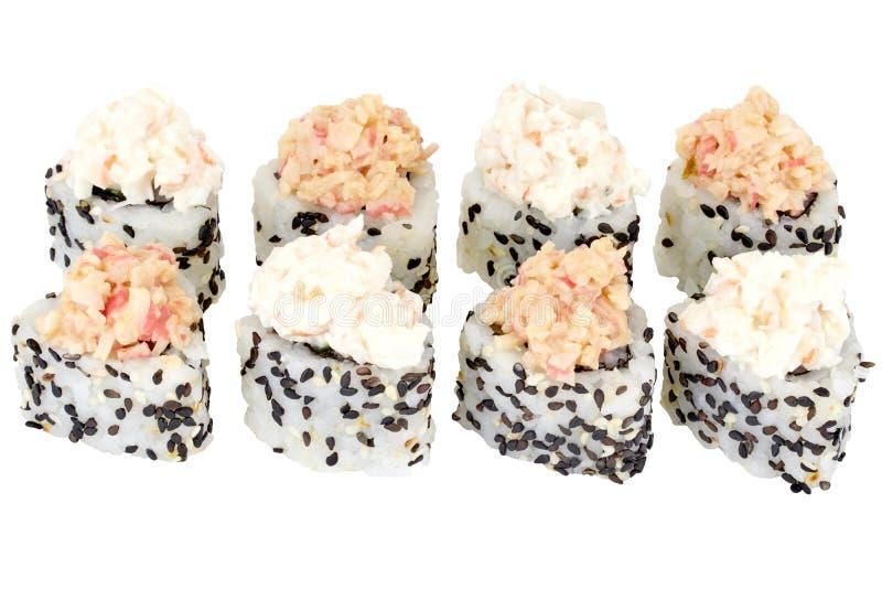 在与蟹肉关闭的白色背景费城寿司卷寿司卷被隔绝的日本料理 免版税库存照片