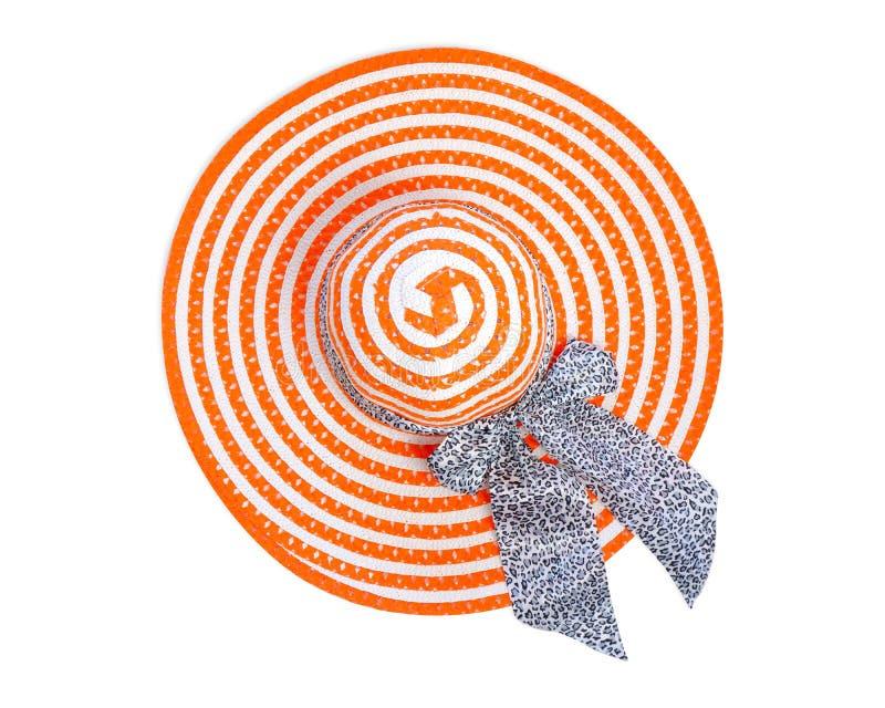 在与裁减路线的白色背景隔绝的夏天橙色懒散的帽子时尚,暑假概念 桔子顶视图  库存照片
