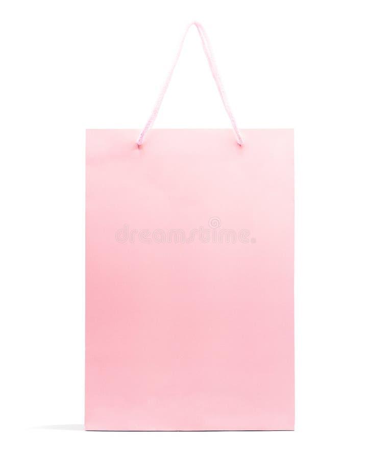 在与裁减路线的白色背景隔绝的桃红色纸袋,购物 免版税库存图片