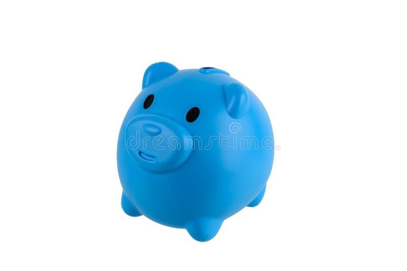 在与裁减路线的白色背景隔绝的蓝色存钱罐救球硬币 免版税库存照片