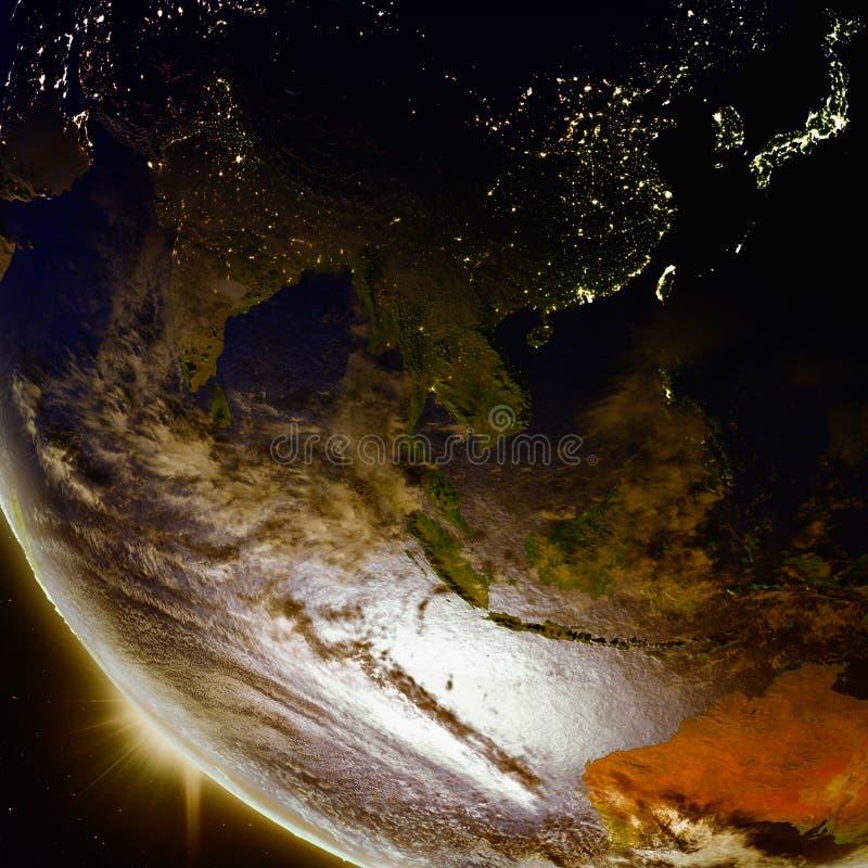 在东南亚上的日落从空间 皇族释放例证