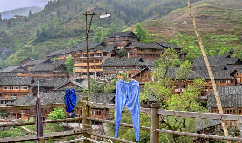 在中国,农民种田的村庄的高地的米大阳台 免版税库存照片