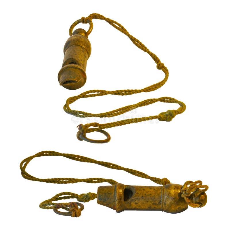 在串的金属黄铜口哨 免版税库存图片