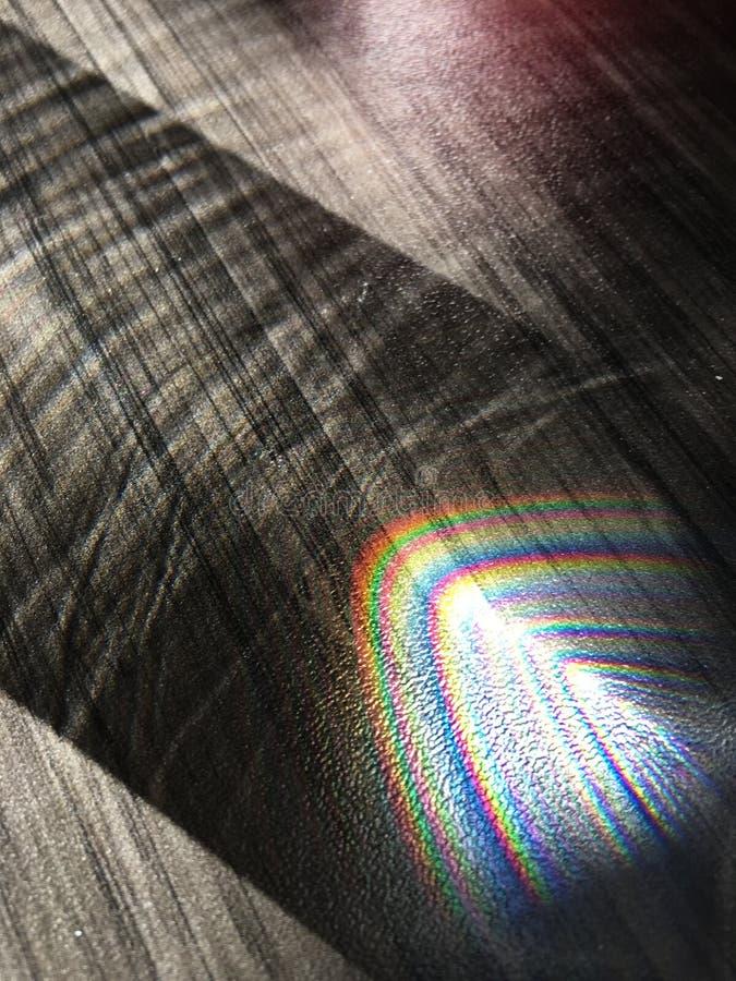 在书桌上的彩虹反射 库存照片
