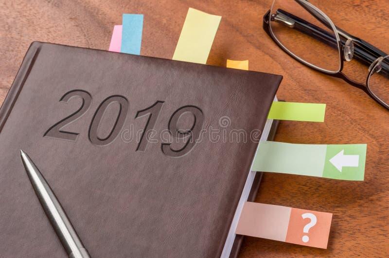 在书桌上的笔记本2019年 免版税库存图片