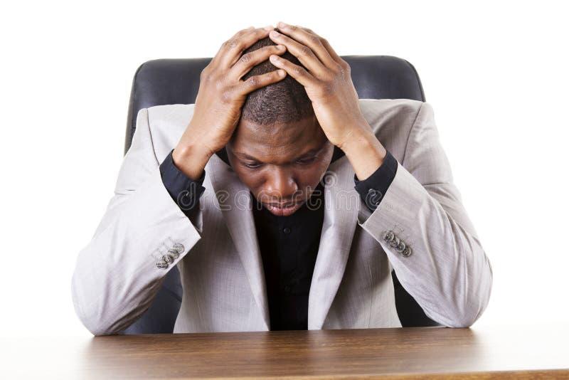 哀伤,疲乏或者沮丧的商人 库存照片