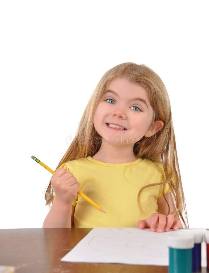 在书桌的小学生文字在白色 免版税库存照片