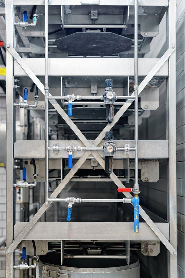 在乳脂制造厂的自动化的设备在法兰奇伯爵大学 库存图片