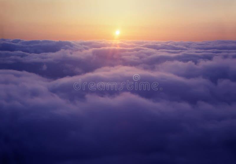 在云彩日落之上 免版税库存图片