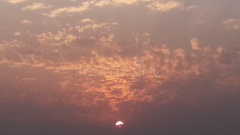在云彩日落之后 库存照片