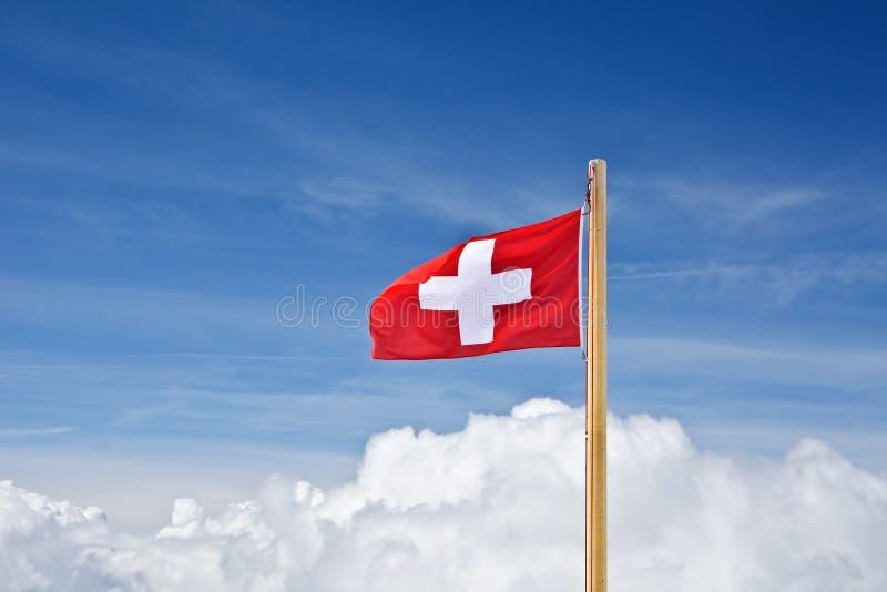 在云彩标志瑞士之上 免版税库存照片