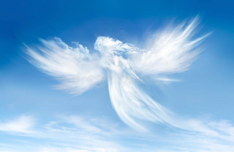 在云彩的天使 免版税图库摄影