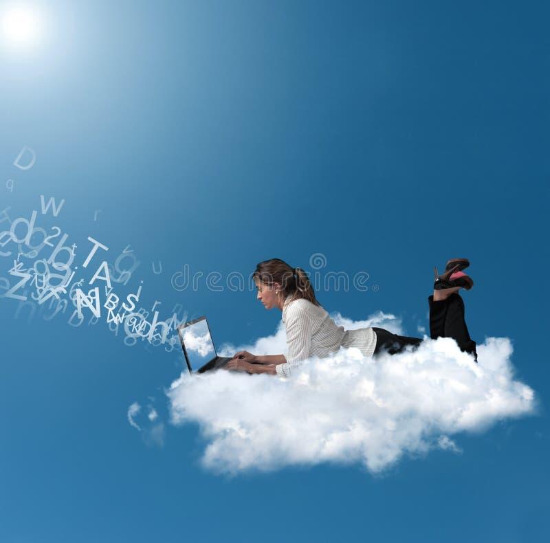 在云彩的女实业家 图库摄影