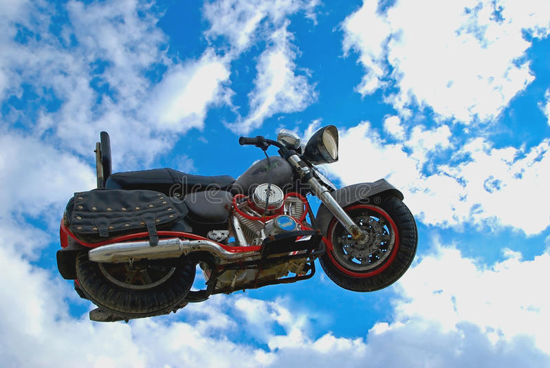 在云彩的摩托车 库存图片