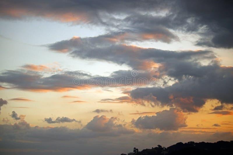 在云彩的软的焕发在日落 免版税库存图片