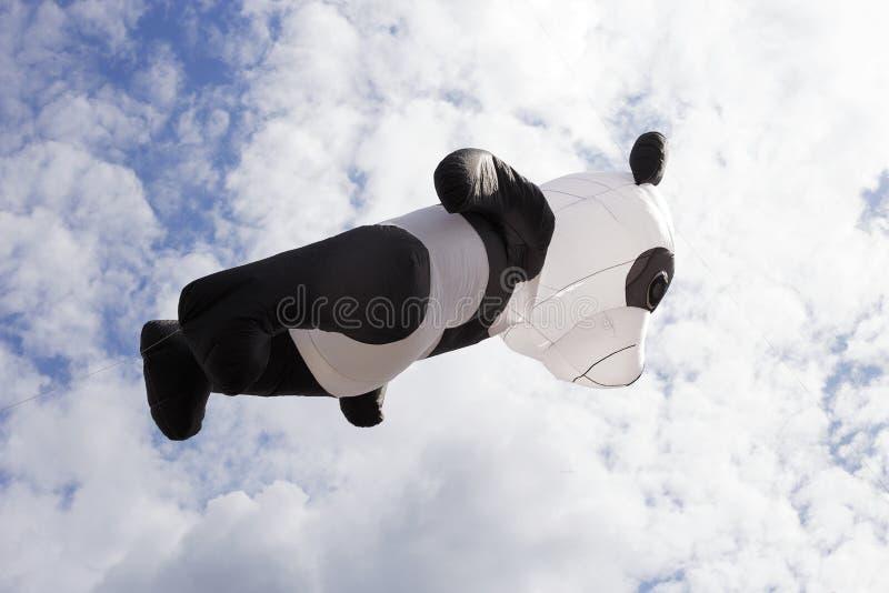 在云彩的风筝飞行 图库摄影