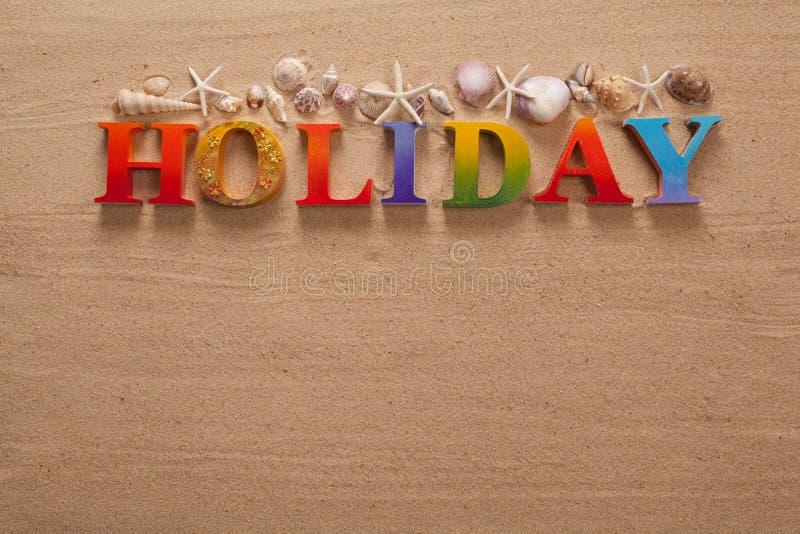 在五颜六色的信件中写道的假日 免版税库存照片