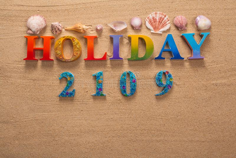 在五颜六色的信件中写道的假日 免版税图库摄影