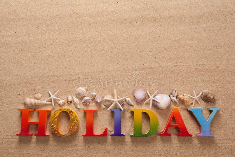 在五颜六色的信件中写道的假日 库存照片