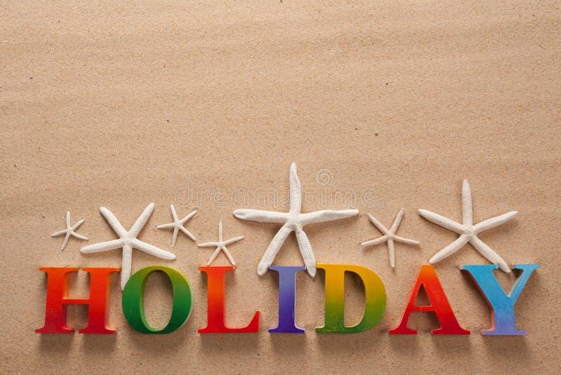 在五颜六色的信件中写道的假日 免版税库存图片
