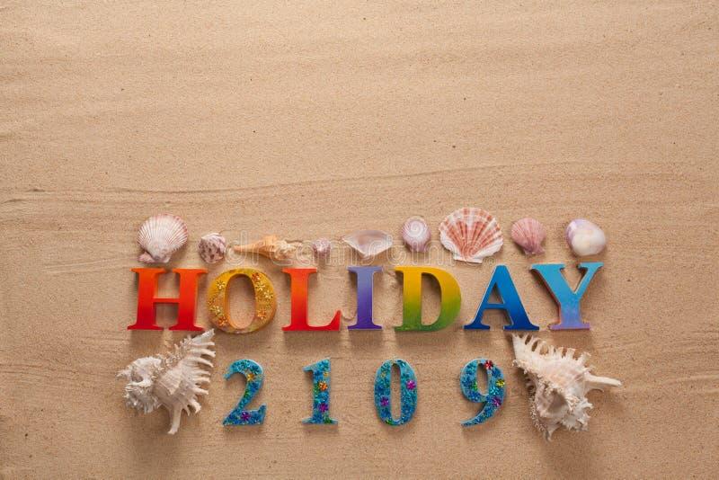 在五颜六色的信件中写道的假日 库存图片