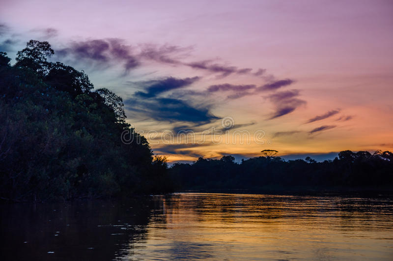 在亚马孙河的日落在巴西 免版税图库摄影