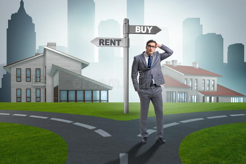 在交叉路betweem购买和租赁的商人 库存照片