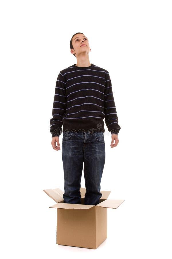在人年轻人里面的配件箱 库存照片